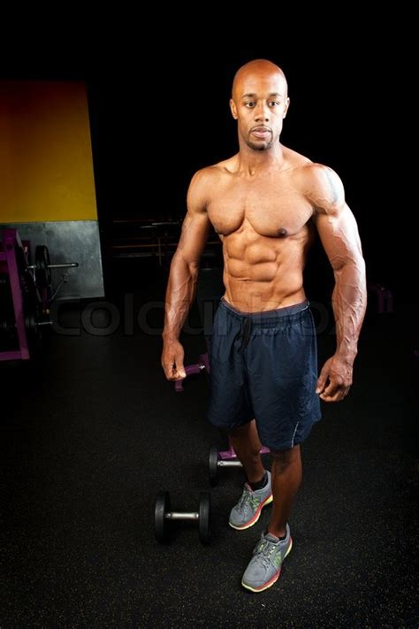 Portrait of a lean toned and ripped muscle fitness man