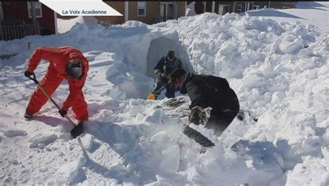 PEI man is forced to dig a giant snow tunnel to find his